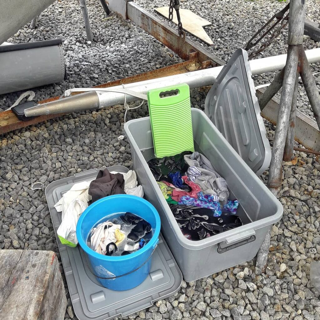 washing laundry in a bucket